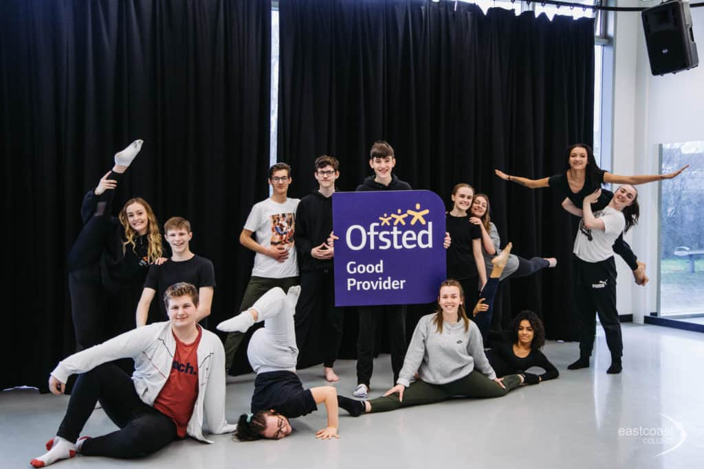 Various college students holding up an Ofsted Good Provider banner